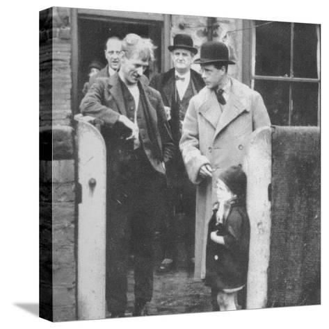 The Prince of Wales visiting a miners cottage in the Northeast of England, 1929 (1936)--Stretched Canvas Print