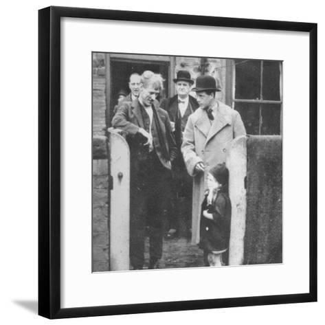 The Prince of Wales visiting a miners cottage in the Northeast of England, 1929 (1936)--Framed Art Print