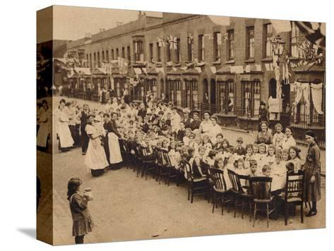 A childrens tea party in an East End Street in London, to celebrate the Treaty of Versailles at t--Stretched Canvas Print
