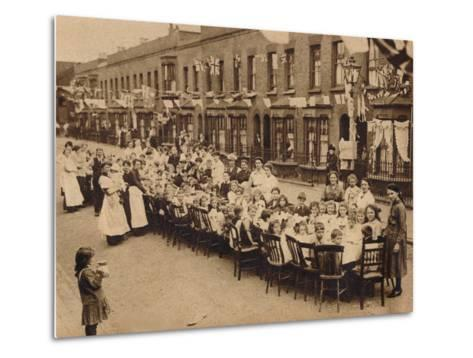 A childrens tea party in an East End Street in London, to celebrate the Treaty of Versailles at t--Metal Print