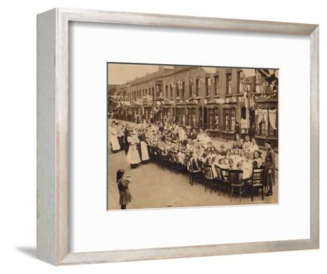 A childrens tea party in an East End Street in London, to celebrate the Treaty of Versailles at t--Framed Art Print