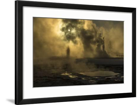 A Woman Vanishes into Steam Clouds from Tardy Geyser in Yellowstone's Upper Geyser Basin-Michael Nichols-Framed Art Print