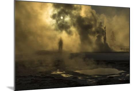 A Woman Vanishes into Steam Clouds from Tardy Geyser in Yellowstone's Upper Geyser Basin-Michael Nichols-Mounted Photographic Print