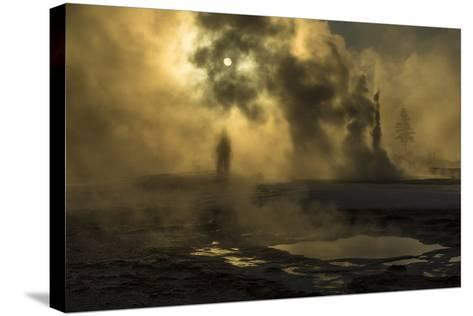 A Woman Vanishes into Steam Clouds from Tardy Geyser in Yellowstone's Upper Geyser Basin-Michael Nichols-Stretched Canvas Print