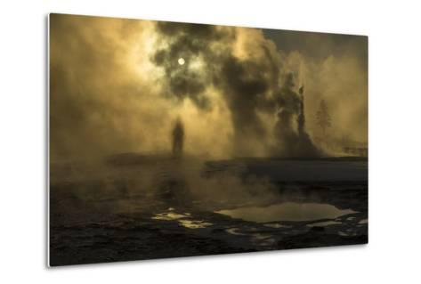 A Woman Vanishes into Steam Clouds from Tardy Geyser in Yellowstone's Upper Geyser Basin-Michael Nichols-Metal Print