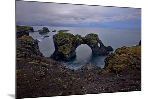 A Natural Arch in Sea Off the Coast of Iceland-Raul Touzon-Mounted Photographic Print