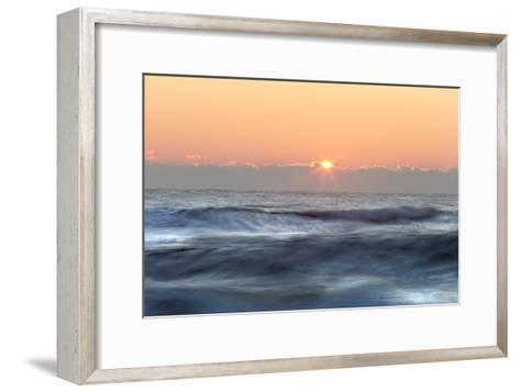 The Last Sliver of Sunlight Shines Rays from Behind Some Clouds-Robbie George-Framed Art Print