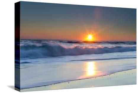 Waves Lap Against the Shore as the Sun Sets-Robbie George-Stretched Canvas Print