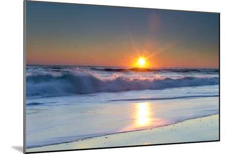 Waves Lap Against the Shore as the Sun Sets-Robbie George-Mounted Photographic Print