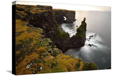 Sea Arch at Sxaholsbarg in Iceland-Raul Touzon-Stretched Canvas Print