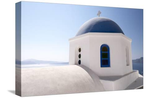 A Classic Blue Dome of a Greek Orthodox Church in Santorini, Greece-Krista Rossow-Stretched Canvas Print