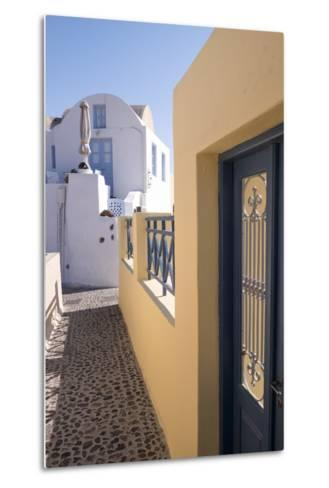 A Colorful Building with a Narrow Path in the Picturesque Town of Oia, Santorini-Krista Rossow-Metal Print