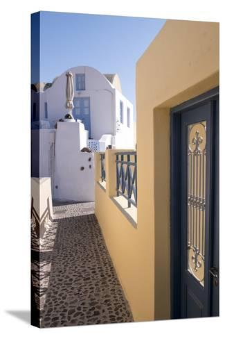 A Colorful Building with a Narrow Path in the Picturesque Town of Oia, Santorini-Krista Rossow-Stretched Canvas Print