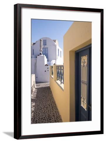 A Colorful Building with a Narrow Path in the Picturesque Town of Oia, Santorini-Krista Rossow-Framed Art Print