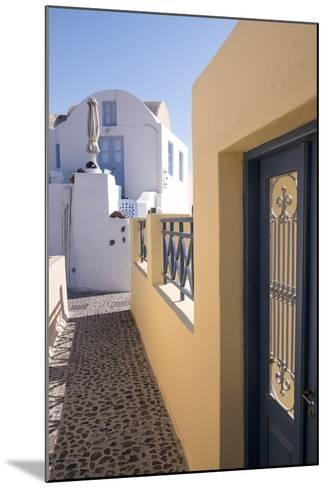 A Colorful Building with a Narrow Path in the Picturesque Town of Oia, Santorini-Krista Rossow-Mounted Photographic Print