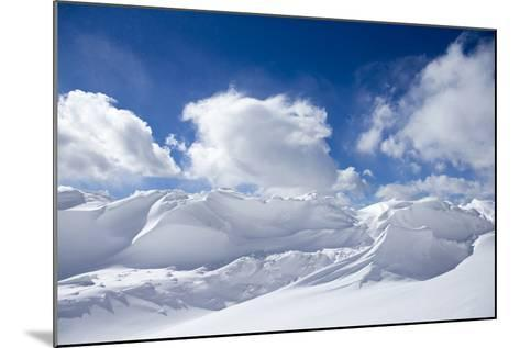 Pristine Snow Drifts Meet Large Puffy Clouds-Robbie George-Mounted Photographic Print