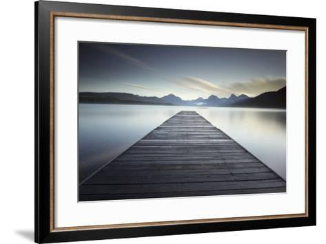 A Pier on the Edge of a Lake in Montana's Glacier National Park-Keith Ladzinski-Framed Art Print