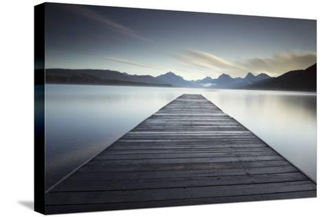 A Pier on the Edge of a Lake in Montana's Glacier National Park-Keith Ladzinski-Stretched Canvas Print