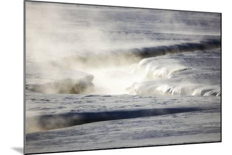 Steam Rises Off the Warm Water Flowing Through a Yellowstone Valley-Robbie George-Mounted Photographic Print