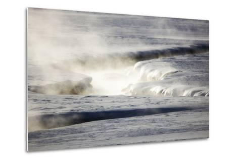 Steam Rises Off the Warm Water Flowing Through a Yellowstone Valley-Robbie George-Metal Print