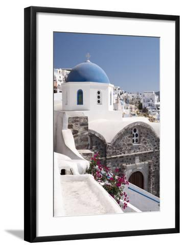 A Classic Blue Dome of a Greek Orthodox Church in the Picturesque Town of Oia, Santorini-Krista Rossow-Framed Art Print