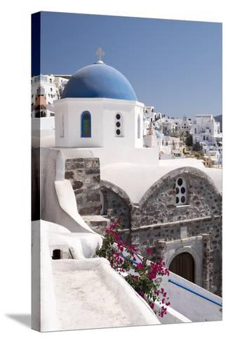 A Classic Blue Dome of a Greek Orthodox Church in the Picturesque Town of Oia, Santorini-Krista Rossow-Stretched Canvas Print