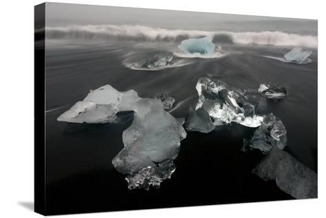 Icebergs and Ice on Black Beach in Iceland-Raul Touzon-Stretched Canvas Print
