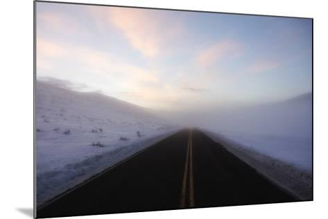 A Bare Roadway Stretches Out into the Misty Frost-Robbie George-Mounted Photographic Print