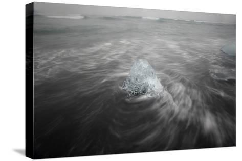 Iceberg on Black Sand Beach in Iceland-Raul Touzon-Stretched Canvas Print