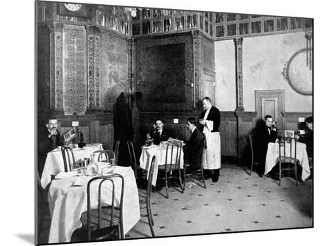 Restaurant Scene from 1910 Showing One Diner Using a Telephone at His Table--Mounted Photographic Print