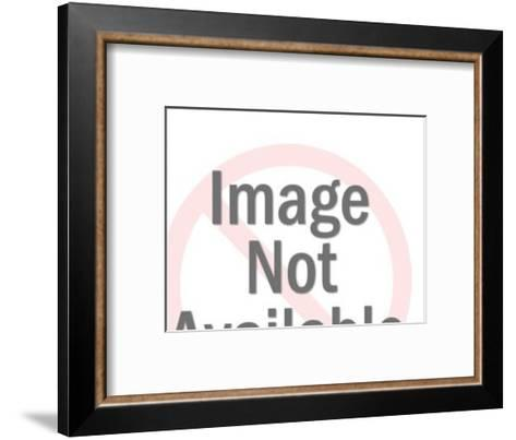 Man Looking at His Watch and Woman in the Background-Pop Ink - CSA Images-Framed Art Print