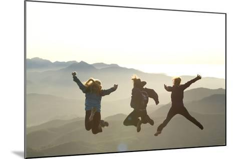 Young Women Jumping On Top Of Mountain. Saddle Mountain State Park, OR-Justin Bailie-Mounted Photographic Print