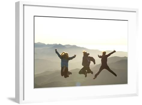 Young Women Jumping On Top Of Mountain. Saddle Mountain State Park, OR-Justin Bailie-Framed Art Print