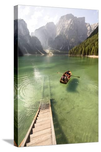 Lake Prags, Prags Dolomites, S Tyrol, Italy: People In Rowing Boat Rowing Out From Rental Station-Axel Brunst-Stretched Canvas Print