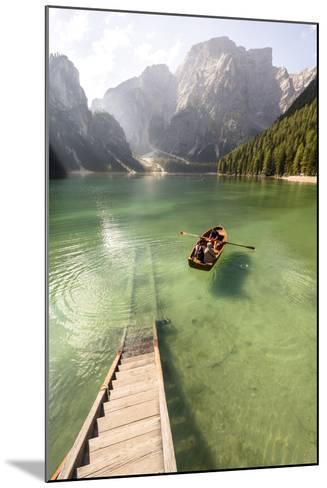Lake Prags, Prags Dolomites, S Tyrol, Italy: People In Rowing Boat Rowing Out From Rental Station-Axel Brunst-Mounted Photographic Print