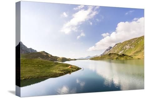Allgäu, Bavaria, GER: Male Backpacker Plunging Into Cold Water Of Schrecksee, Allgäu Alps-Axel Brunst-Stretched Canvas Print