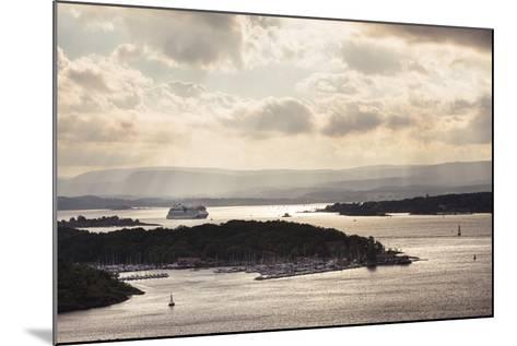 Oslo, Østlandet, Norway: Cruise Ship Aidaluna Entering Oslo Harbor In Late Afternoon-Axel Brunst-Mounted Photographic Print