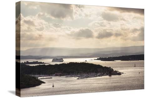 Oslo, Østlandet, Norway: Cruise Ship Aidaluna Entering Oslo Harbor In Late Afternoon-Axel Brunst-Stretched Canvas Print