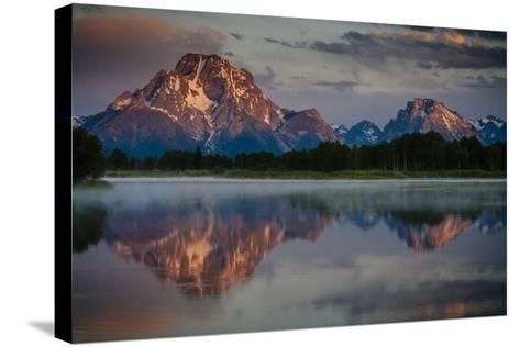 The Sun Rises Through The Clouds At Oxbow Bend In Grand Teton National Park, Wyoming-Jay Goodrich-Stretched Canvas Print