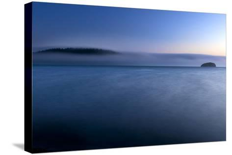 The Fog Rolls Back Into Martha's Beach At Sunset In Washington-Jay Goodrich-Stretched Canvas Print