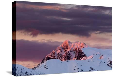 Sun Turns The Peaks Of The Cascades Crimson As Evening Approaches In The Mount Baker Backcountry-Jay Goodrich-Stretched Canvas Print