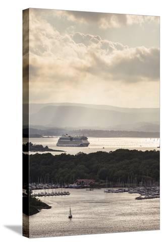 "Oslo, Østlandet, NOR: Cruise Ship Aidaluna, Oslo Harbor, ""Ekebergrestauranten"" Hillside Restaurant-Axel Brunst-Stretched Canvas Print"
