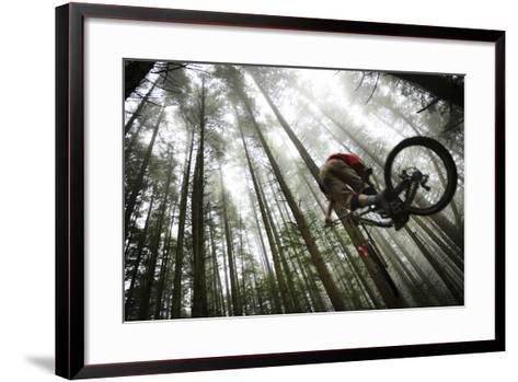 Mountain Biker Catches Air In The Mist Of The Northwest Rainforest Near Bellingham, WA-Jay Goodrich-Framed Art Print