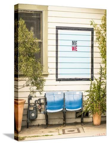 Venice, California, USA: Two Seats In Front Of A House With A Hand Painted Sign Reading 'Me We'-Axel Brunst-Stretched Canvas Print