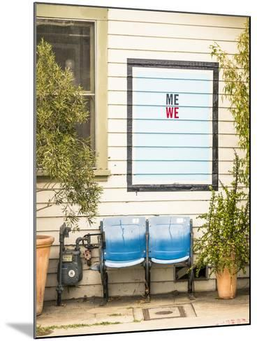 Venice, California, USA: Two Seats In Front Of A House With A Hand Painted Sign Reading 'Me We'-Axel Brunst-Mounted Photographic Print