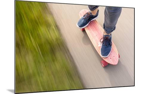 A Man Cruising Along On His Skateboard-Axel Brunst-Mounted Photographic Print
