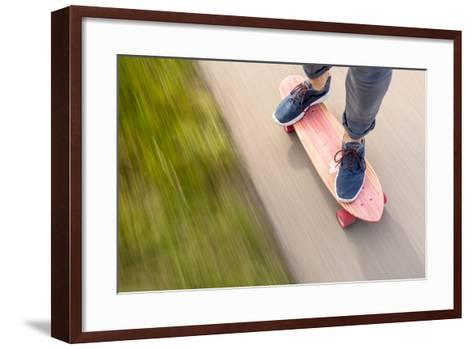 A Man Cruising Along On His Skateboard-Axel Brunst-Framed Art Print