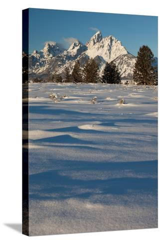 Clouds Drift In The Teton Mountain Range In Front Of Fresh Snow Just After A Winter Sunrise-Greg Winston-Stretched Canvas Print