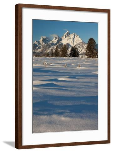 Clouds Drift In The Teton Mountain Range In Front Of Fresh Snow Just After A Winter Sunrise-Greg Winston-Framed Art Print