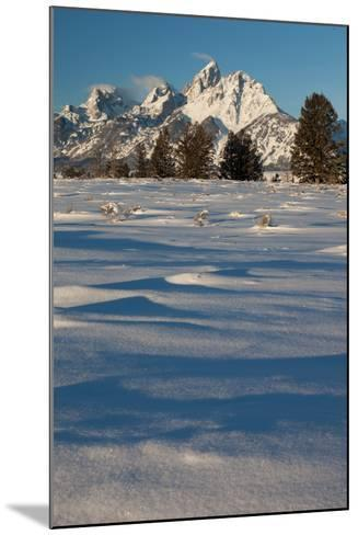 Clouds Drift In The Teton Mountain Range In Front Of Fresh Snow Just After A Winter Sunrise-Greg Winston-Mounted Photographic Print